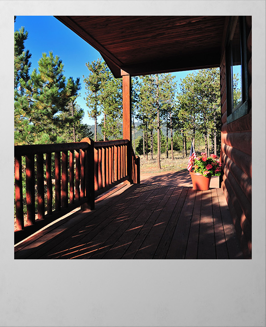 Polaroid image of cabin deck in Woodland Park Colorado