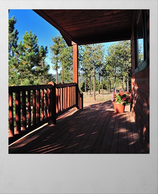Polaroid image of cabin deck in Woodland Park Colorado